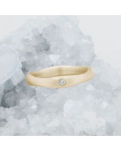 Classic stacking ring hand-molded and cast in 10k yellow gold with a 2mm birthstone or diamond