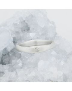 Classic stacking ring hand-molded and cast in 10k white gold with a 2mm birthstone or diamond