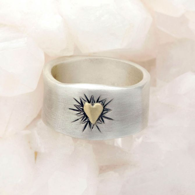 Bursting heart ring hand-molded sterling silver finished with a 10k yellow gold heart and hand-engraved with sunburst design