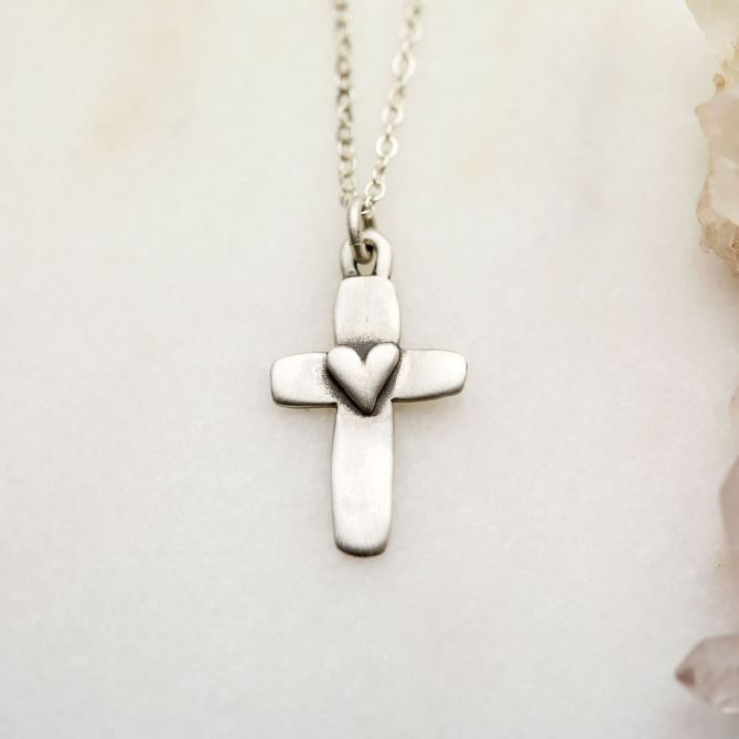 Handcrafted sterling silver cross of faith necklace strung on a sterling silver link chain