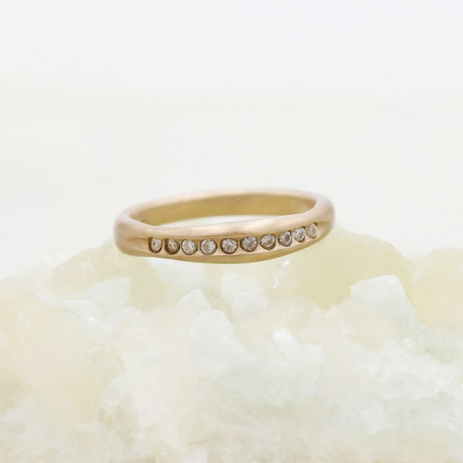 Passage ring handcrafted in 14k yellow gold and display of 1.5mm cubic zirconias