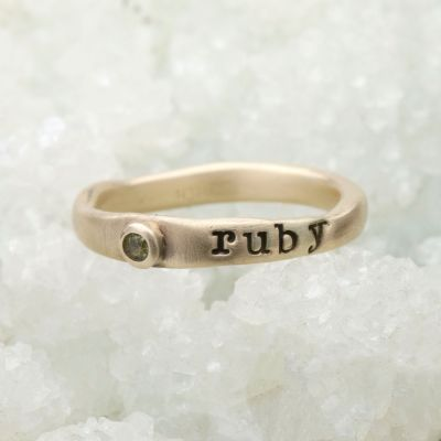 Personalized passage ring handcrafted in 10k yellow gold with your choice of birthstone