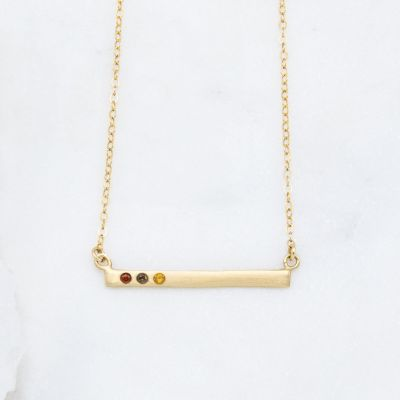 14k yellow gold cross bar birthstone necklace strung on a gold-filled link chain customizable with up to 7 genuine 2mm birthstones