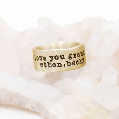 Band together ring handcrafted in 14k yellow gold with an antiqued/satin finish and personalized with words, names, or a quote