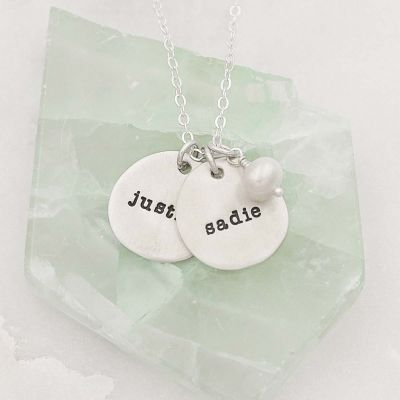 Beloved name disc handcrafted in sterling silver hung with a vintage freshwater pearl and customizable with a name or word