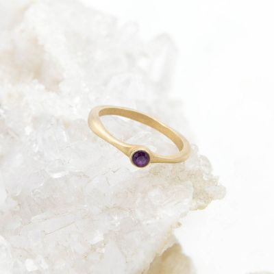Bezel birthstone ring handcrafted in 14k yellow gold set with a 3mm birthstone inside a gold bezel