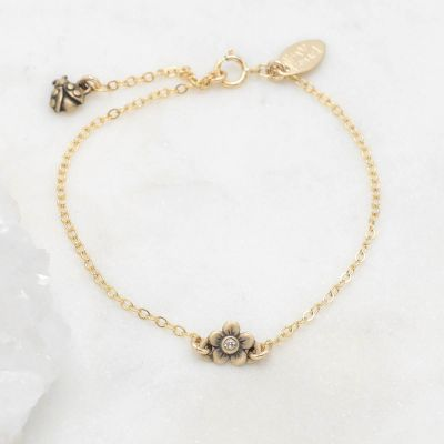 14k gold birthstone bloom bracelet with sweet flower charm and 14k yellow gold lady bug charm