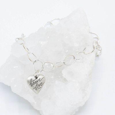 Sterling silver Brave Love emblem bracelet with a matte brushed finish