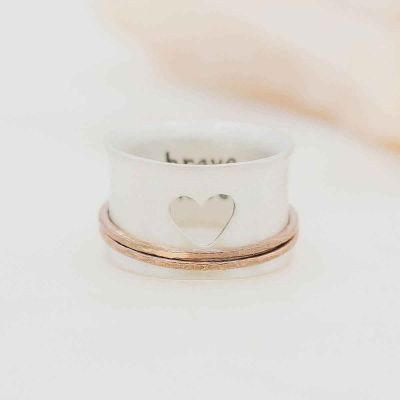 brave love® spinner ring {sterling silver & bronze} on marble background