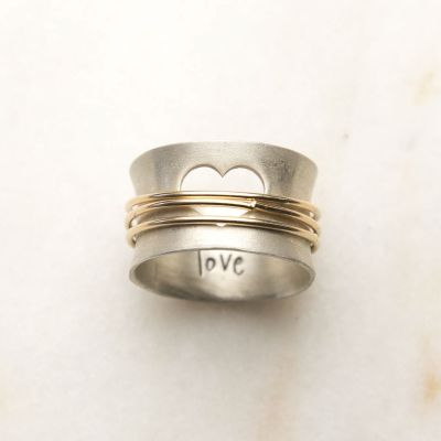 """Brave Love spinner ring with a sterling silver band and gold-filled spinners and engraved with """"brave love"""" on the inside"""