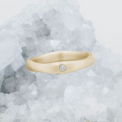 Classic stacking ring hand-molded and cast in 14k yellow gold with a 2mm birthstone or diamond