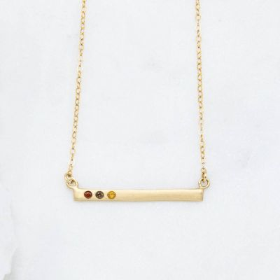 10k yellow gold cross bar birthstone necklace strung on a gold-filled link chain customizable with up to 7 genuine 2mm birthstones