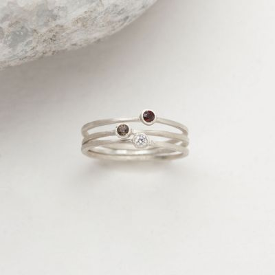 Dainty finespun ring trio handcrafted in sterling silver set with 3 birthstones