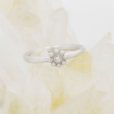 Forever flower wedding ring hand-molded and cast in 10k white gold set with a 3mm birthstone or diamond