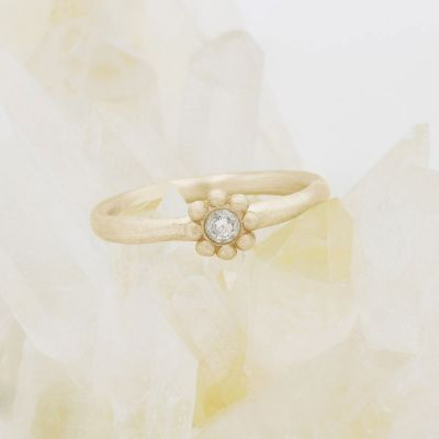 Forever flower wedding ring hand-molded and cast in 14k yellow gold set with a 3mm birthstone or diamond