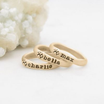 furry footprint 10k yellow gold stacking rings personalized with pet names