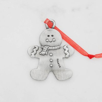 Gingerbread boy ornament  hand-molded and cast in fine pewter hung from a sheer red ribbon with a personalized word