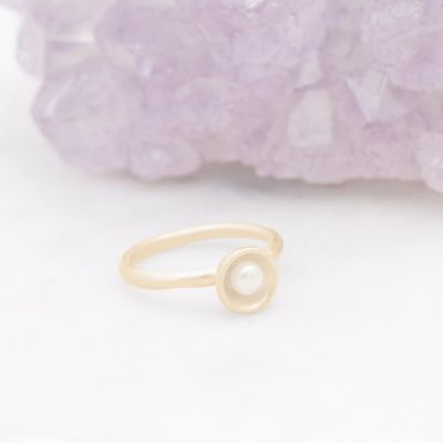 Nesting freshwater small pearl ring hand cast in 10k yellow gold holding inside a small 4mm freshwater pearl