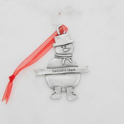 Snowman ornament hand-molded and cast in pewter hung from a sheer red ribbon and personalized with a phrase