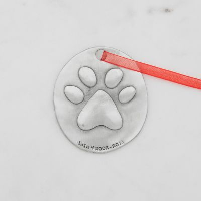 furry footprint ornament hand-molded and cast in fine pewter and personalized with a meaningful name, phrase or date