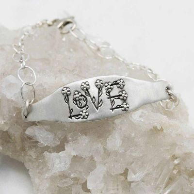 Handcrafted Love and Wildflowers sterling silver bracelet with a matte brushed finish