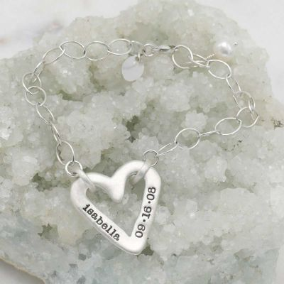Handcrafted sterling silver molded heart bracelet with a freshwater pearl