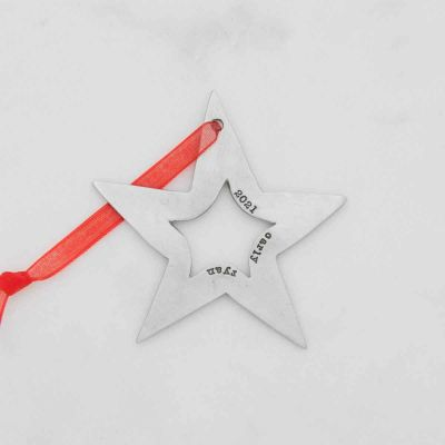 Molded star ornament hand-molded and cast in fine pewter hung from a sheer red ribbon and customizable with a up to five words