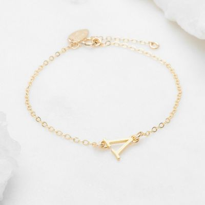 14k yellow gold monogram bracelet with a satin finish