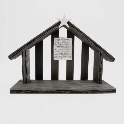 handcrafted wooden nativity stable  that includes a pewter star and a hand-stamped poem