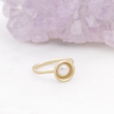 Nesting freshwater large pearl ring hand cast in 10k yellow gold holding inside a large 6mm freshwater pearl