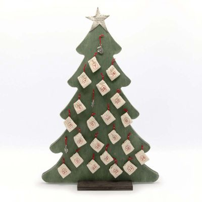 """Wooden our Christmas tradition advent calendar  with 24 tiny pewter ornaments tucked in numbered muslin bags and hung from metal pegs topped with a pewter star hand-stamped with """"Christmas is coming?"""""""