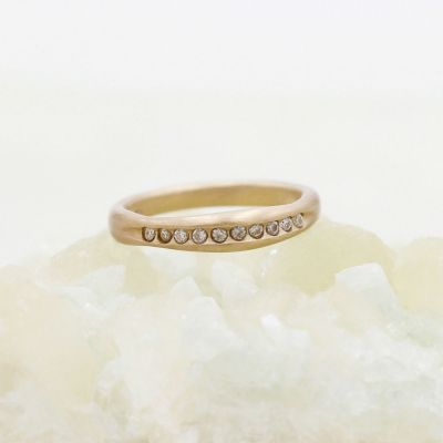 Passage ring handcrafted in 10k yellow gold and display of 1.5mm cubic zirconias