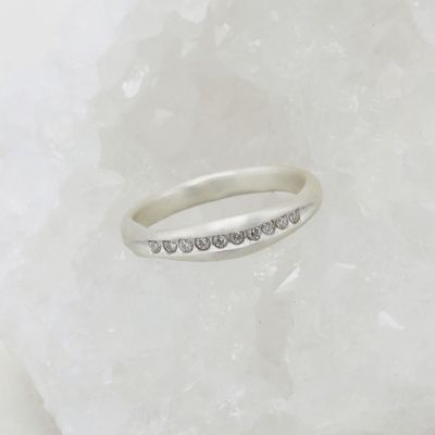 Passage ring handcrafted in sterling silver and display of 1.5mm cubic zirconias