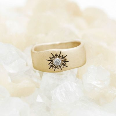 10k yellow gold sunburst diamond ring with a 3mm conflict free diamond