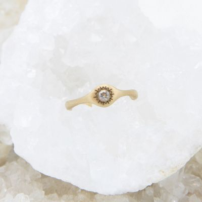 Sunburst stacking ring handcrafted in 14k yellow gold and set with a 3mm bright genuine diamond