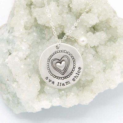 Personalized sterling silver original brave love necklace with a matte brushed finish and strung on a sliver link chain