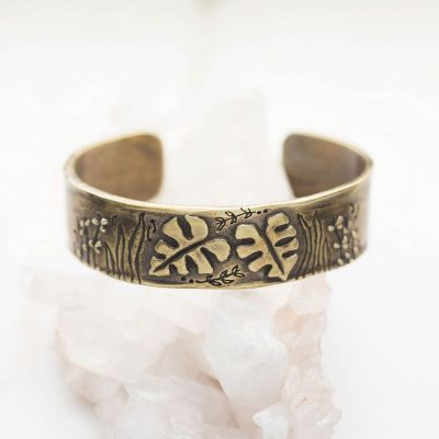 Handcrafted bronze-plated thrive cuff
