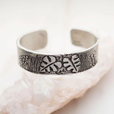 Handcrafted pewter thrive cuff