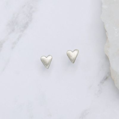 sterling silver tiny heart stud earrings with a matte brushed finish
