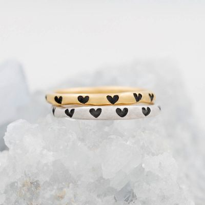 Tiny hearts stacking ring handcrafted in yellow gold plated sterling silver with a satin finish stackable with other mix and match rings