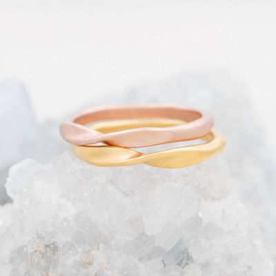 Twists and turns stacking ring handcrafted in yellow gold plated sterling silver with a satin finish stackable with other mix and match rings