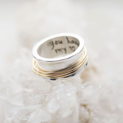 You Have my Heart Spinner ring with a sterling silver band and gold-filled spinners and phrase engraved on the inside