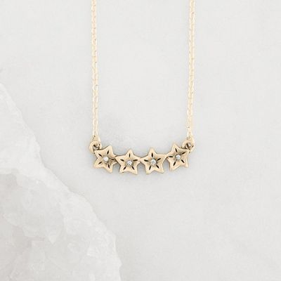 10k yellow gold your spark necklace with 1.5mm cubic zirconia in each star and strung on gold-filled chain chain