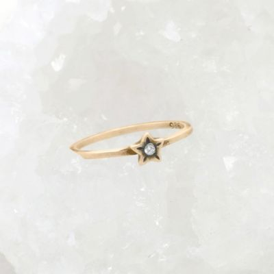 Your spark ring handcrafted in 10k yellow gold with a 1.5mm cubic zirconia stone stackable with multiple rings